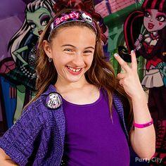 Throw on a few add-ons like a Monster High Headband or bracelet for fashionably fierce attire :)