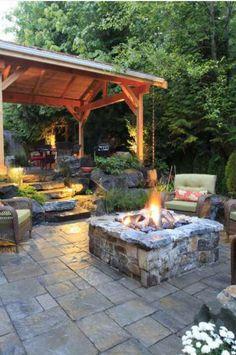 Landscaped patio w/ stone fire pit