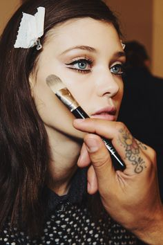 makeup at gucci fall 2014-- never been able to do this type of eyeliner without looking weird.