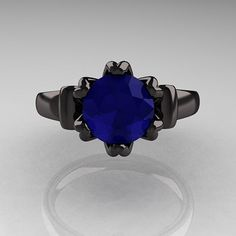 I don't know if I really like it....but I still think it's cool just because it reminds me of a superhero! ha! Antique 14K Black Gold 1.5 CT Blue Sapphire Designer Engagement Ring
