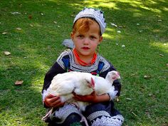 Kalash Girl With Her Chickens