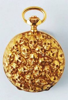 Pocket Watch by Rene Lalique, Ca. 1900. Yellow gold, classical watch mechanism, decorated with masks, after a drawing by Rodin.