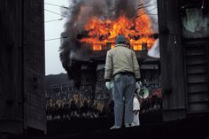 Akira Kurosawa considers an explosion on the set of RAN.