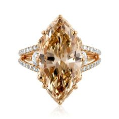 The award winning Yael Designs 'Morning Star' ring features a 6.97ct marquise-cut cognac diamond set in 18k rose gold with white diamond flanks.
