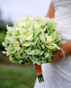 Classic green bouquet with pale hydrangeas and orchids