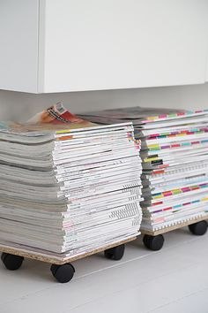 Magazine storage - i'd choose different casters but great idea!