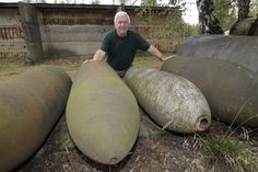 This gentleman is hugging unexploded WW2 aerial bombs that have surfaced in Germany 60 years after the end of hostilities. The innocent appearance of these beasts is deceiving. Thousands of un-exploded aerial bombs turn up in Germany each year, most of them live. A particular area of concentration is Berlin itself, with Hamburg and Dresden also in the top leagues.