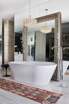 Love the idea of a large mirror in the bathroom