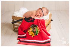 Blackhawlks Newborn Picture - Sports pose for newborn photography