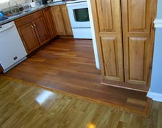 Wood Look Tiles.  Get the beauty of wood floors while waving off potential scratches, termite or water damage, thanks to eye-fooling ceramic and porcelain tiles.  Several examples on this site and discussion of pro and con.