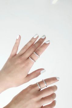 white nails + silver rings