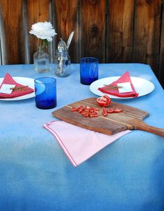 We love a good outdoor entertaining project. Learn how to make this stunning ombre tablecloth using a spray bottle dye technique and a painter's drop cloth.
