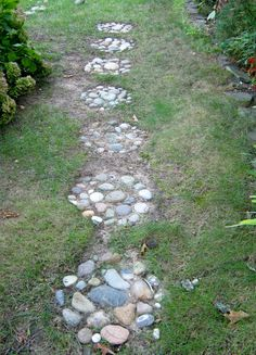 """Make a stepping stone path with rocks and stones you collect on vacations."""