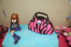 Rice Crispy purse and fondant Clawdeen by A Good Time for Cake, Morgan Hill, CA.