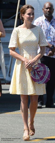 Leaving the Solomons for Tuvalu  In primrose   broderie anglaise dress by independent dress maker, Stuart Weizmann sandals, and Kiki McDonough citrine earrings, and fan