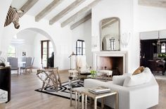 Open spaces, beautiful beams & gorgeous archway...Ryan Street & Associates Living Room
