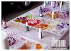 """Make """"spray paint"""" from acrylics and water in spray bottle. Make stencils with acetate sheets and silhouette -- perhaps even of some of Arwen's drawings."""