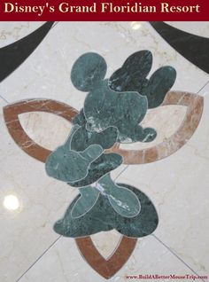 Minnie Mouse inlay in the marble floor in the lobby at Disney's Grand Floridian Resort.  For more resort photos, see: http://www.buildabettermousetrip.com/disneys-grand-floridian   #Minnie Mouse #GrandFloridian #Disneyworld #WDW