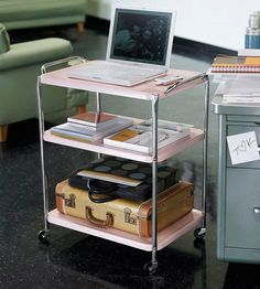 Carting Around  Turn an old cart into a mobile office. Lower shelves can store notebooks and boxes for supplies and paperwork (try using a vintage suitcase to corral everything). Plus, the cart can be pulled up to an armchair or couch, and the top surface can be used as a laptop workstation.