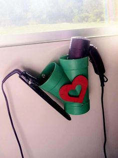 Now that's a damn good idea, a DIY holder for curling iron & hair blower!!