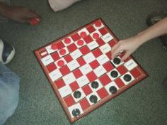 "Purchase a checkers board (Wal-Mart) and place velcro on the black squares on the game board. Print, laminate, and cut on the following squares on the above template and place corresponding velcro pieces on the back. Place the words with prefixes and suffixes in random order on the game board. Each time a player moves a checker they must say the prefix or suffix, read the word, and explain what it means. (The template ""Common Prefixes/Suffixes"" from above can help children as they are playing this game)."