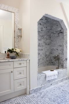 Anne Hepfer Designs: Spectacular master bathroom features marble-top vanity accented with small stone Buddha ...