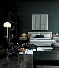 Dark grey hardwood floor + black walls + great styling.
