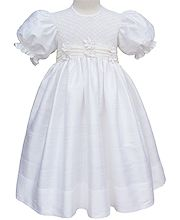 This is a beautiful Ivory silk smocked dress. It has an organza pleated sash completed with delicate flowers and seed pearls at the waist line with tied bow and silk covered buttons at the back. The sleeves are finished with smocking. This would be the perfect dress for Easter Sunday, First Communion, Flower Girl dress or any other special occasion.