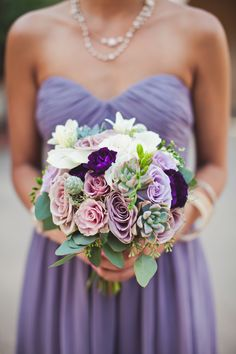 Bridesmaid bouquet with various shades of purple and white flowers by Cherry Blossom Floral Design - photo by The Rasers | via junebugweddings.com