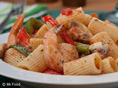 Shrimp 'n' Pasta - Finally--a seafood dinner everyone can agree on! This shrimp and pasta dinner recipe cooks up in only 20 minutes, making it perfect for a weeknight dinner. Our recipe includes bell peppers, mushrooms, garlic, tomatoes, cheese, and more!
