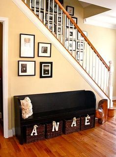 I recently bought an old pew for my mud room. I so want to paint it black like this and I LOVE the baskets with initials