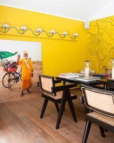 The yellow dining area of La Banane. May 2013 Lonny Magazine