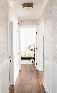 white + gold floral wallpaper in hallway