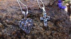 I have the traditional cross with the heart in the center but just saw the heart with the cross in the center.  I love her jewelry.