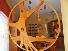 Awesome wooden display with squirrels in the tree holes!