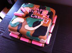 Girl camo cake with pink shotgun shells made of fondant.