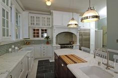 kitchens - sage green walls vintage penny tiles slate inset tiles coffee stained kitchen island white kitchen cabinets marble countertops farmhouse sink turned legs green blue glass subway tiles backsplash beadboard ceiling sink in kitchen island Restoration Hardware Clemson Pendant