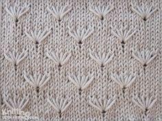 Field of Dandelion flowers . Knit loops 3 stitches below