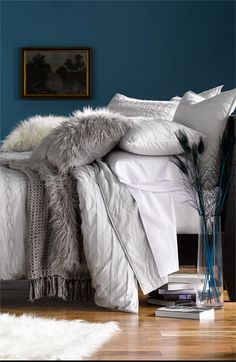 faux fur pillows and cotton bedding