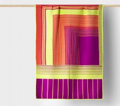 Tabula Rasa's colorful knit blankets and pillows are SO pretty