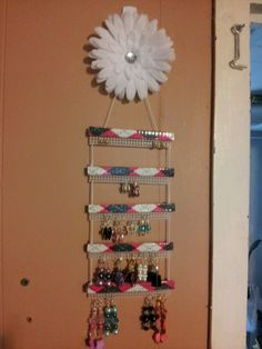 earring organizer. I used duct tape, popcicle sticks, plastic canvas and sting. The top is a purchased hair clip.