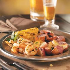 Low Country Grill Recipe - tentative followup to Dave's description of shrimp, clams, kielbasa, cooked red and white new potatoes, and old bay, in foil on the grill 10 minutes. (Low Country is normally a stew)