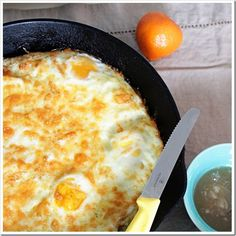 Baked Eggs with Crispy Hash Brown Crust Recipe ~ Eggs topped with cheese with a crispy hash brown crust hidden below... only three ingredients: potatoes, eggs, and cheese. Easy and delish!