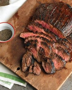 Soy-Marinated Flank Steak :: 1 cup soy sauce 1/4 cup packed light-brown sugar 3 tablespoons cider vinegar 1 tablespoon Worcestershire sauce 2 teaspoons Dijon mustard 1 teaspoon red-pepper flakes 1/4 teaspoon ground pepper 1 flank steak (about 2 pounds) Vegetable oil, for grates Put sauce on the meat for 2-3 hrs turning. Grill or bake