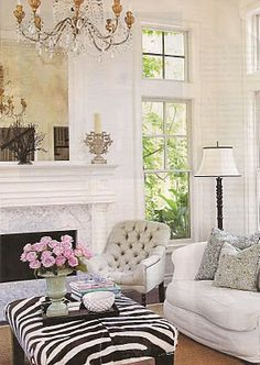 Eclectic Chic living room with a zebra ottoman.