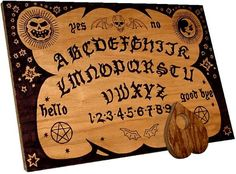 "Ouija Board -- also known as a spirit board or talking board. Flat board marked with the letters of the alphabet, the numbers 0-9, the words ""yes"", ""no"", ""hello"", & ""goodbye"", along with various symbols and graphics.  Participants place their fingers on a planchette (small heart-shaped piece of wood) or movable indicator to indicate the spirit's message by spelling it out on the board during a séance. Seemingly ""just"" a game, this can be a dangerous portal through which evil spirits enter."