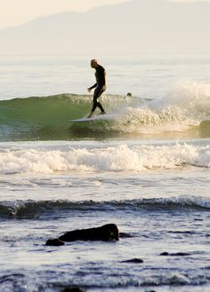 """Michael Kew on a 9'4"""" Andreini pig at Rincon March 3rd. Photos by David Pecchi."""