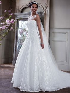 Angelic lace and breathtaking beaded appliques make this strapless wedding dress that much more timeless and elegant! Style WG3561 #davidsbridal #weddings #aislestyle