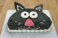 - Credit: Kiedrowski's Bakery - What a cute idea...turn a half of a cake into a kitty