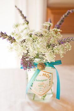 white flowers, french bottl, vintage bottles, vintage labels, vintag french, flower centerpieces, ana rosa, mason jars, diy centerpieces